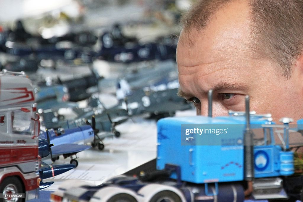 A man looks at a fire engine model at the model-making exhibition Modellbrno in Brno, Czech Republic on June 22, 2013. The exhibition is the largest one-day European get-together for plastic scale modelers who compete in 60 competition classes. Various themed exhibitions attract thousands of visitors to the event that takes place since 1994. AFP PHOTO/ RADEK MICA