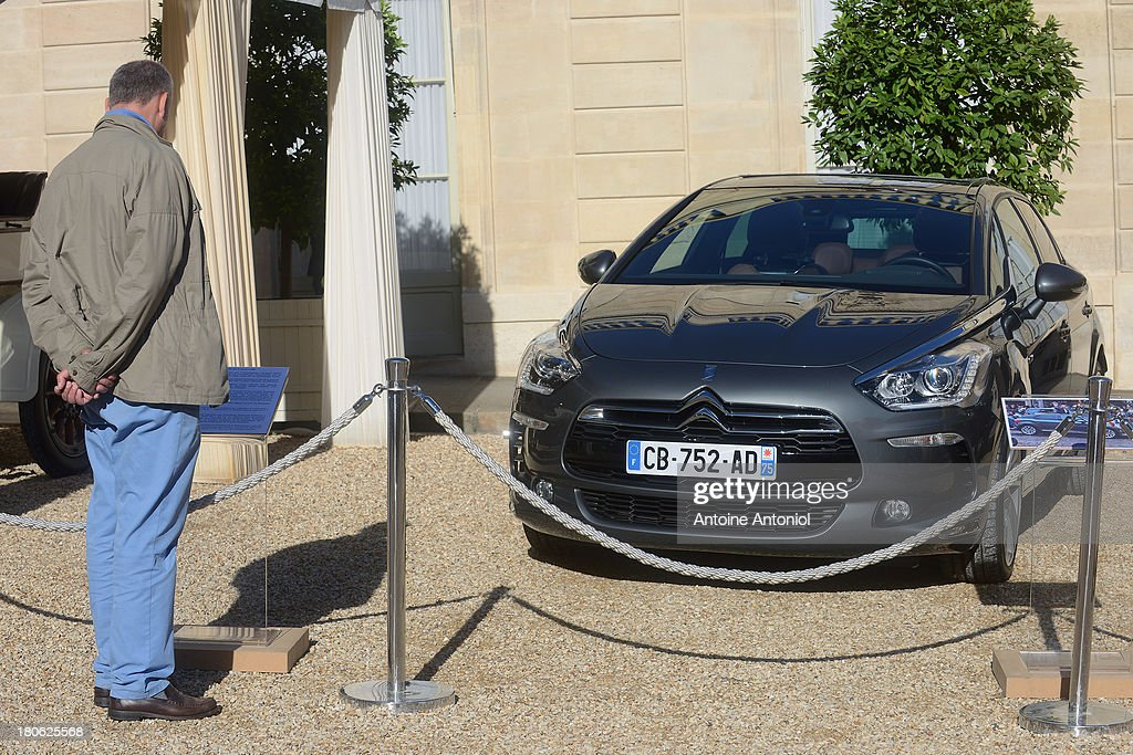 A man looks at a French Presidential car at the Elysee Presidential Palace during the 30th edition of France's European heritage days on September 15, 2013 in Paris, France. Monuments and state buildings are opened for free for two days to the public.
