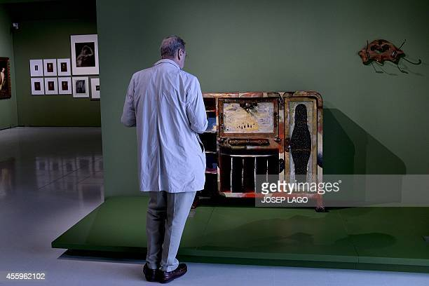A man looks at a furniture designed by Spain's Josep Maria Jujol as part of a new Modern art collection on September 23 2014 at the National Art...