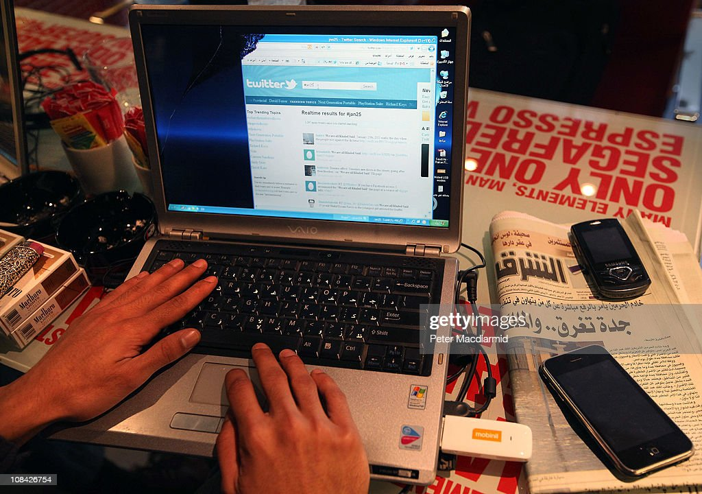 A man looks at a laptop computer displaying Twitter in a cafe on January 27, 2011 in Cairo, Egypt. People across Egypt have used Twitter and other social media to mass organise protests with the searchable hashtag, #jan25. Thousands of police are on the streets of the capital and hundreds of arrests have been made in an attempt to quell anti-government demonstrations.