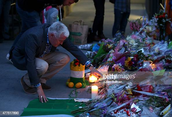 A man looks at a makeshift memorial outside of an apartment where six students died in an early Tuesday morning balcony collapse on June 17 2015 in...