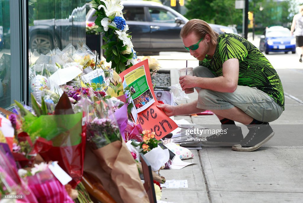 A man looks at a memorial to deceased actor Cory Monteith outside the Fairmont Pacific Rim Hotel on July 16, 2013 in Vancouver, British Columbia, Canada. The B.C. Coroners Service released results of Monteith's autopsy today and found the 31-year-old's cause of death was a mixed drug toxicity involving heroin and alcohol.