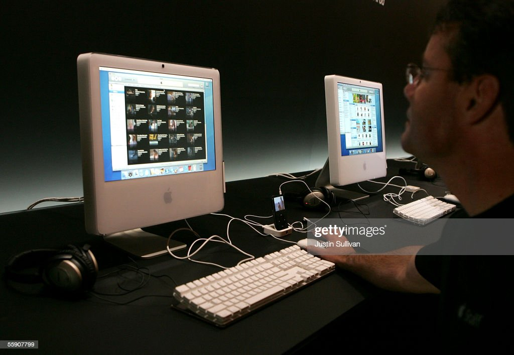 A man looks at a new iMac on display at a special event announcing new Apple products October 12, 2005 in San Jose, California. Apple CEO Steve Jobs announced a new iPod that plays video, a new iMac and new version of iTunes that allows people to purchase videos and television shows.