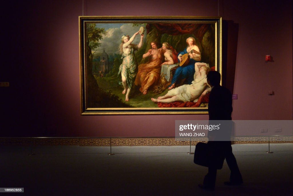 A man looks at a painting as he visits an exhibition at China's National Museum in Beijing on November 5,2013. Royal collections of Liechtenstein, including works by Rubens, Van Dyck and other Flemish painters, are being held at China's National Museum from November 5, 2013 to February 15, 2014.