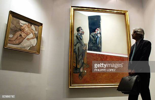 A man looks at a painting by Francis Bacon estimated between 357 and 50 million Hong Kong dollars displayed during Christie's Hong Kong Spring...