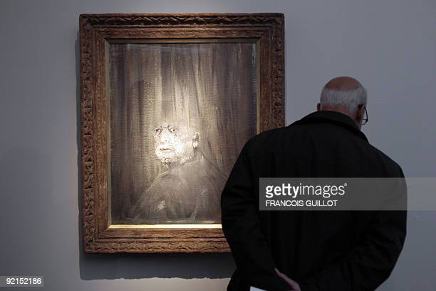 A man looks at a painting by Irish artist Francis Bacon during the 36th international contemporary art fair FIAC on October 21 2009 at the Grand...