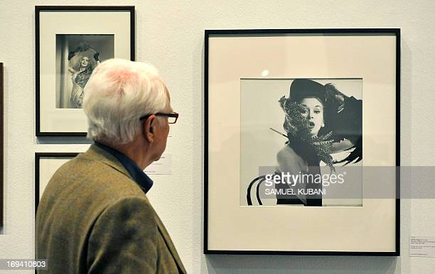 A man looks at a photograph 'Woman in Chicken hat' by Irving Penn at photo prints auction on May 24 2013 at the Westlicht photo gallery in Vienna...