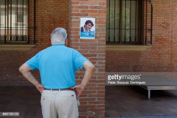 A man looks at a placard calling for a vigil to honour London Bridge terror attack hero Ignacio Echevarria on June 8 2017 in Las Rozas Madrid...