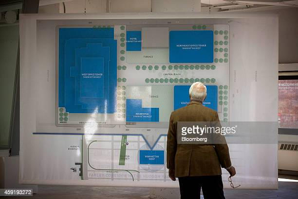 A man looks at a plan for the Brookfield Office Properties Inc Manhattan West deck platform that covers the railroad tracks leading to Penn Station...