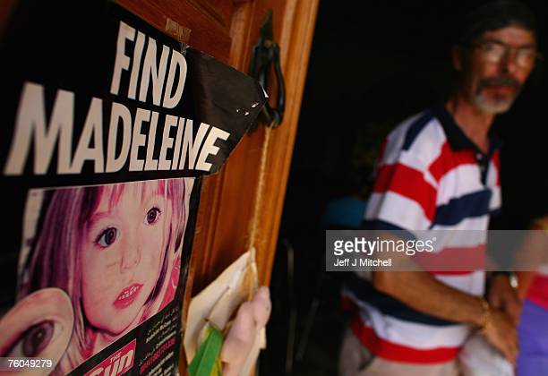 A man looks at a poster placed on the Church door in Praia da Luz for missing Madeleine McCann August 10 2007 in Praia da Luz Portugal Police...