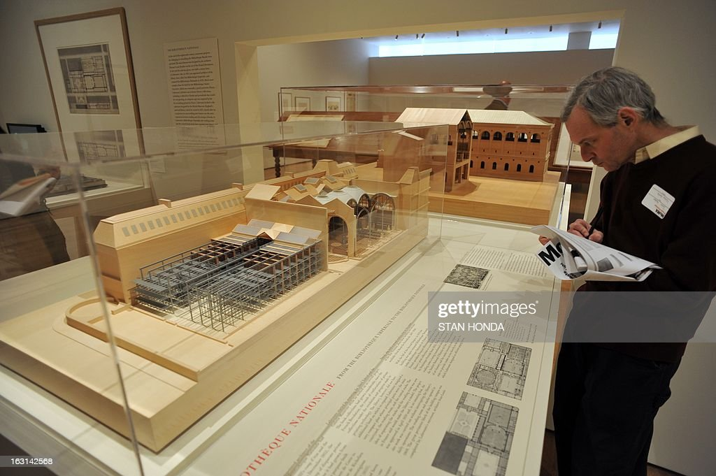 A man looks at a 'Sectional model of the Biblioteque Nationale through the stacks and reading room' made in 2012, part of the exhibit, 'Henri Labrouste: Structure Brought to Light' about the French architect HenrI Labrouste on view during a preview March 5, 2013 at the Museum of Modern Art in New York. The exhibition highlights his work in modern architecture and libraries in particular and is open March 10 to June 24. It is organized by MOMA, Cité de l'architecture & du patrimoine and Bibliothèque nationale de France. AFP PHOTO/Stan HONDA