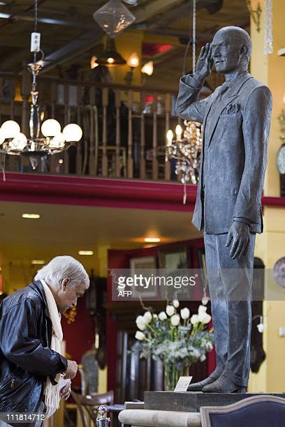 A man looks at a statue of murdered Dutch politician Pim Fortuyn on April 7 2011 during viewing days at an auction house in Diemen The bronze statue...