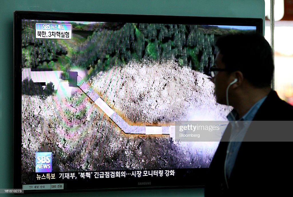 A man looks at a television screen showing a news broadcast on North Korea's nuclear test at Yongsan Station in Seoul, South Korea, on Tuesday, Feb. 12, 2013. North Korea held its third nuclear test today, underscoring a disregard for an international community that has already isolated the totalitarian state from the global economy. Photographer: SeongJoon Cho/Bloomberg via Getty Images