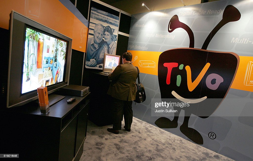 A man looks at a Tivo display at the 2005 Consumer Electronics Show January 6, 2005 in Las Vegas, Nevada. The 1.5 million square foot electornic gadget show begins on Thursday and runs through Sunday and is expected to attract over 120,000 attendees.