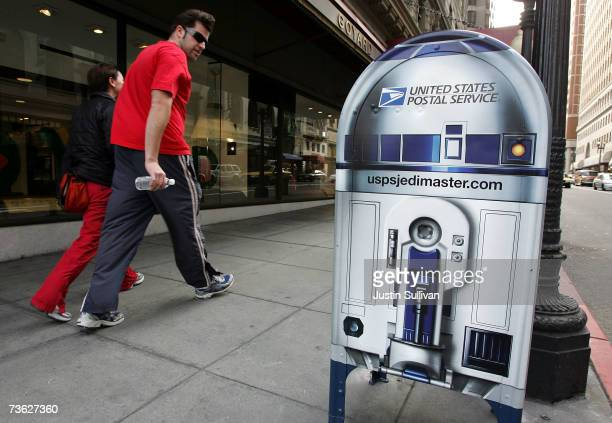 A man looks at a US Postal Service mailbox designed to look like Star Wars character R2D2 March 18 2007 in San Francisco California The US Postal...