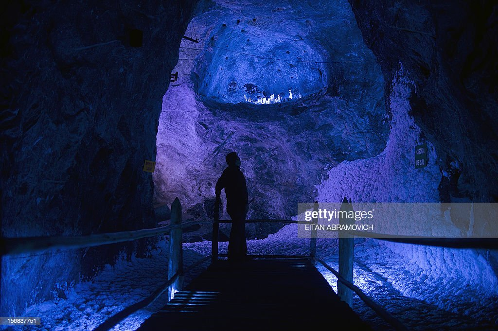 A man looks at a waterfall of salt at Nemocon's salt mine in Nemocon, Cundinamarca, Colombia on November 22, 2012. The mine, an impressive construction at 80 meters of depth with over 500 years of history, has become a new attractive tourist destination in Colombia. AFP PHOTO/Eitan Abramovich
