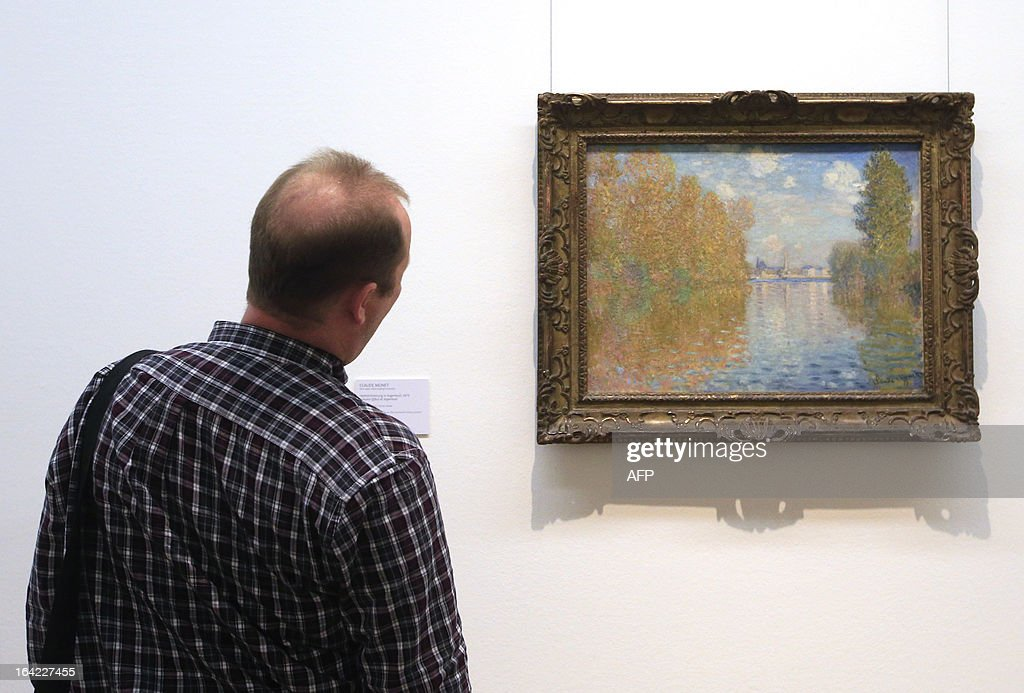 A man looks at an artwork creation by French artist Claude Monet, titled 'Autumn effect at Argenteuil',dated 1873, as part of the 'Clouds' (Wolken) exhibition at the Leopold Museum in Vienna, on March 21, 2013. The exhibition will run until July 1, 2013.
