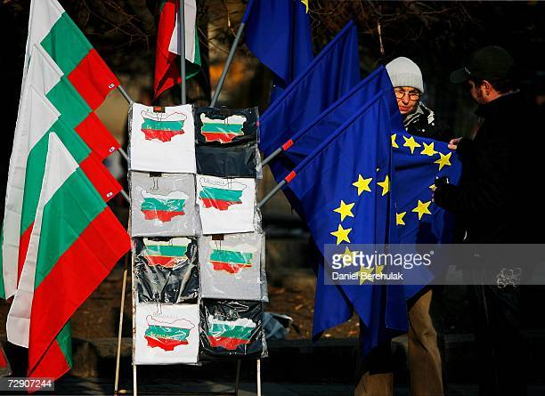 A man looks at an EU flag before purchasing it from a street vendor on December 31 2006 in Sofia Bulgaria Bulgaria and Romania will join the European...