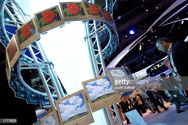A man looks at an exhibit of Samsung high definition televisions at the 2003 International Consumer Electronics Show January 9 2003 in Las Vegas The...
