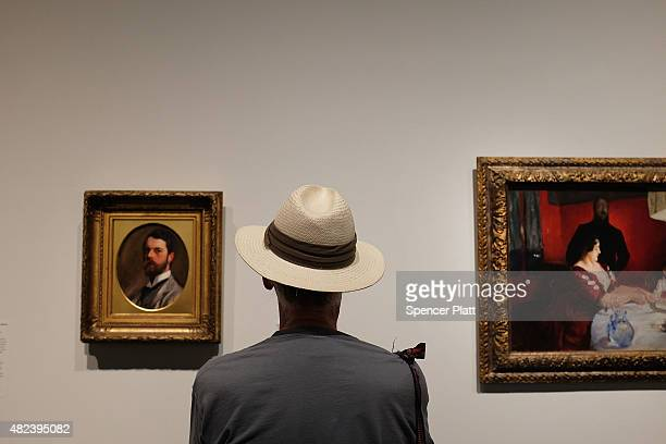 A man looks at an exhibition at the Metropolitan Museum of Art on July 30 2015 in New York City The Met recently announced that it drew 63 million...