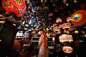 A man looks at antiques on display at Cenral Souq on July 22 2015 in Sharjah United Arab Emirates