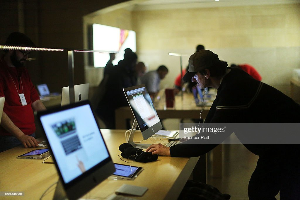 A man looks at Apple products at the Apple retail store in Grand Central Terminal on December 10, 2012 in New York City. Apple Inc. stock was down $4.56 per share, or 0.86 percent decline as investors and analysts worry that the U.S market is becoming saturated with apple products. Apple, the world's most valuable publicly traded company, has lost $167 billion in market value in less than three months.