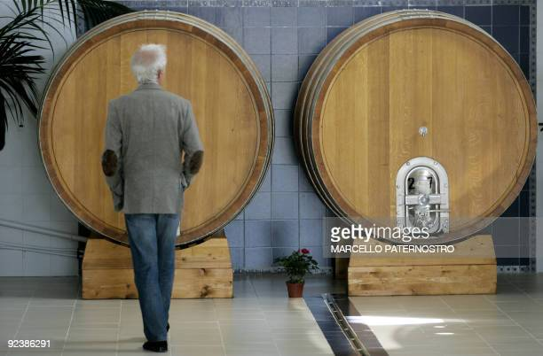 A man looks at barrels in 'Centopassi' factory in San Cipirello on October 27 2009 during the official opening ceremony Libera an Italian association...
