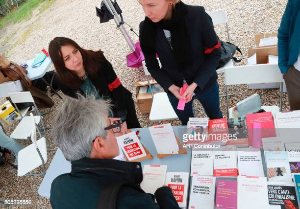 A man looks at books displayed at a stand during a rally for the launch of a movement led by French Socialist member Benoit Hamon in Reuilly on July...
