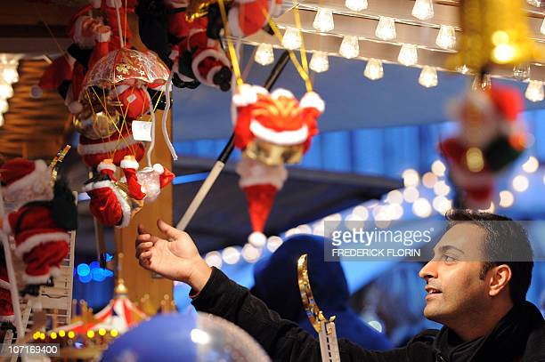 A man looks at Christmas decorations on November 27 2010 during the opening of the Strasbourg Christmas market which is the largest and one of the...