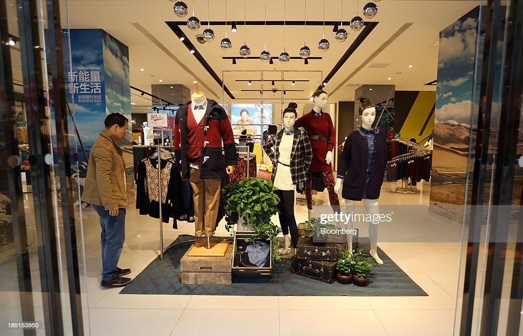 A man looks at clothing displayed at a store in Wuhan, China, on Thursday, Oct. 17, 2013. China is scheduled to release third-quarter gross domestic product figures on Oct. 18. Photographer: Tomohiro Ohsumi/Bloomberg via Getty Images