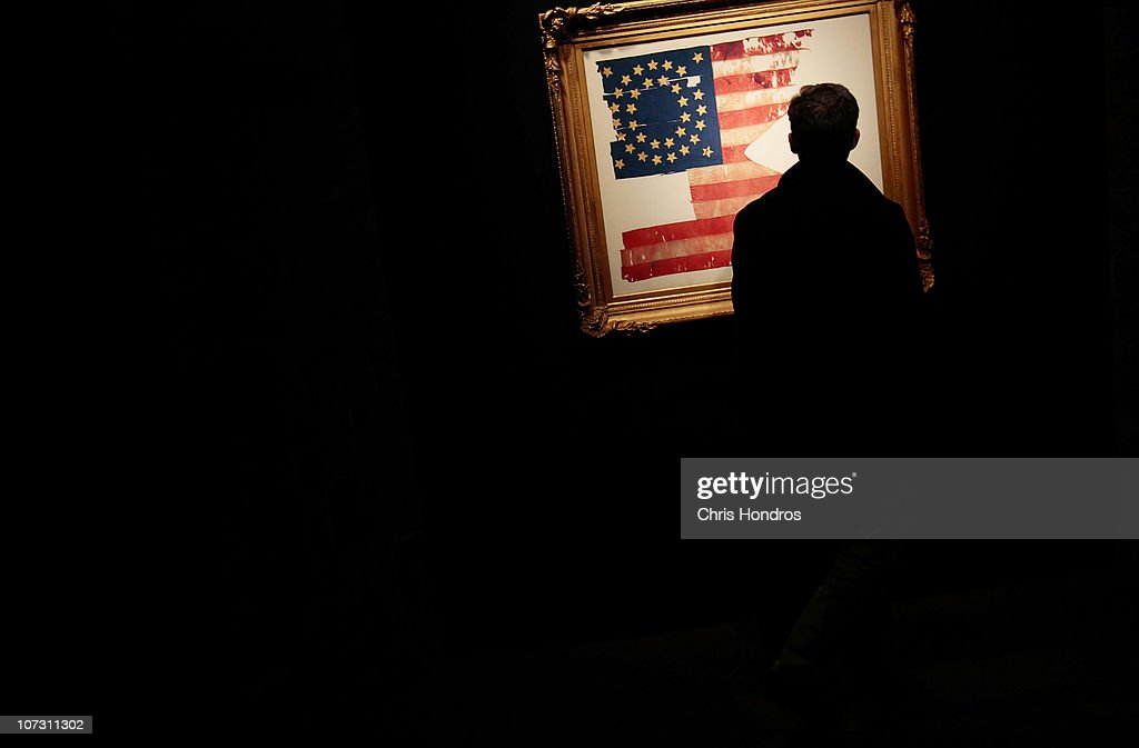 A man looks at 'Custer's Last Flag' at Sotheby's auction house December 3, 2010 in New York City. The flag, one of the few remnants of the famous 1876 battle in which General George Custer and his men were slaughtered by a band of Native American warriors after he staged a misgiuded attack, is billed as 'the most significant and symbolic artefact recovered from the Little Bighorn battlefield' and is scheduled to be auctioned on December 10.