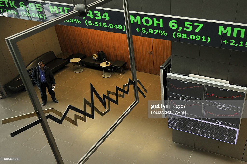 A man looks at electronic displays at the Athens stock exchange on October 27 2011 Greece reacted with measured relief on Thursday after European...