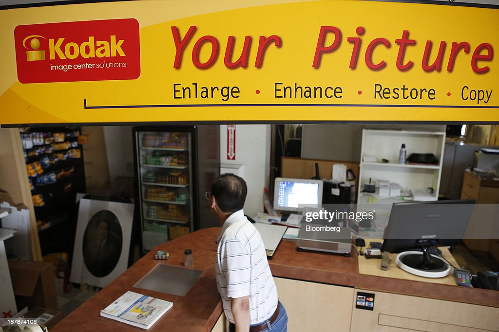 A man looks at film inside a Kodak Image Center Solutions location in Glendale, California, U.S., on Tuesday, Nov. 12, 2013. Eastman Kodak is scheduled to release earnings figures on Nov. 14. Photographer: Patrick T. Fallon/Bloomberg via Getty Images