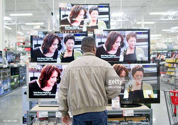 A man looks at flat screen televisions inside a BJ's Wholesale Club store in Falls Church Virginia US on Thursday Dec 30 2010 BJ's Wholesale Club Inc...