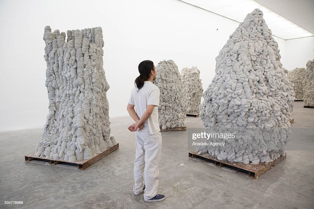 A man looks at 'Ga Gu Ma' by Indian-British sculptor Anish Kapoor during the exhibition press preview of 'Archaeology: Biology' at University Museum of Contemporary Art in Mexico City, Mexico on May 27, 2016. This exhibition offers a wide-ranging perspective on Kapoors workwith sculptures dating from 1980 to 2016.