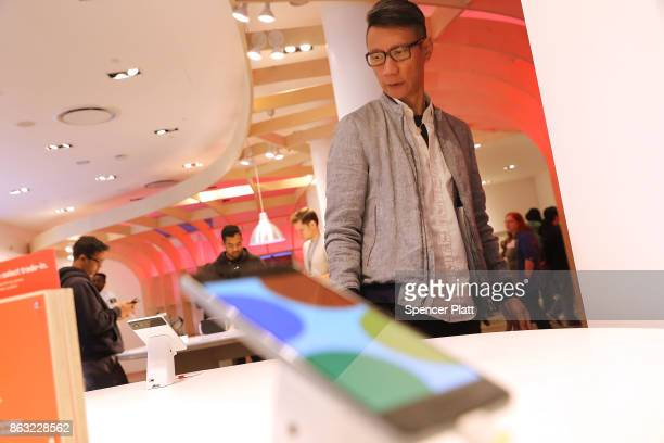 A man looks at Google's new Pixel 2 phones at a New York City popup shop on October 19 2017 in New York City The temporary store in the Flatiron...