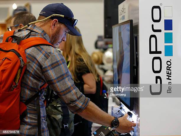 A man looks at GoPro Inc cameras on display during the 2015 Outdoor Retailer Summer Market show at the Salt Palace Convention Center in Salt Lake...