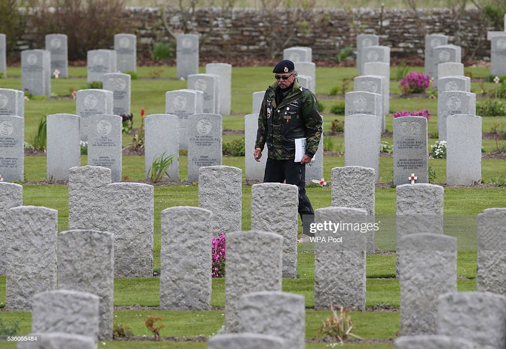 A man looks at graves after attending a service during the 100th anniversary commemorations for the Battle of Jutland on May 31, 2016 in Hoy, Scotland. The event marks the centenary of the largest naval battle of World War One where more than 6,000 Britons and 2,500 Germans died in the Battle of Jutland fought near the coast of Denmark on 31 May and 1 June 1916.