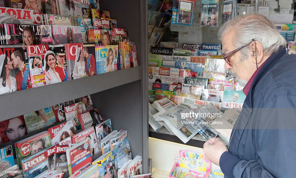 A man looks at Italian magazines that shows pictures of the the Royal Highnesses Prince William, Duke of Cambridge and Catherine, Duchess of Cambridge on May 03, 2011 in Milan, Italy. The marriage of the second in line to the British throne was led by the Archbishop of Canterbury and was attended by 1900 guests, including foreign Royal family members and heads of state. Thousands of well-wishers from around the world flocked to London to witness the spectacle and pageantry of the Royal Wedding.