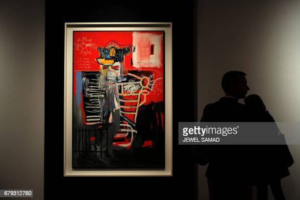 CORRECTION A man looks at JeanMichel Basquiat 'La Hara' during Christie's press preview of the 20th Century Week in New York on May 5 2017 Christie's...