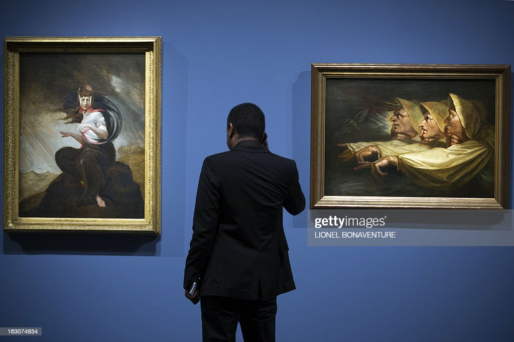 A man looks at 'La folie de Kate' (L) and 'Les trois sorcieres' (R) paintings by Johann Heinrich Fussli displayed during the exhibition 'The Angel of the Odd. Dark Romanticism from Goya to Max Ernst' at the Orsay museum in Paris, on March 4, 2013. The exhibition will run from March 5 until June 9, 2013.
