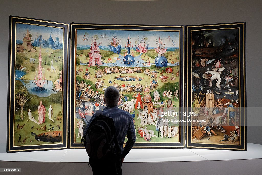 A man looks at of 'The Garden of Earthly Delights Triptych' from Dutch painter Hieronymus Bosch during a press preview at El Prado Museum on May 27, 2016 in Madrid, Spain. The Prado Museum holds the 'El Bosco' (Hieronymus Bosch) painter major exhibition to celebrate the fifth century anniversary of the Dutch artist's death (ca. 1450-1516) featuring sixty five works from various Spanish and global museums.