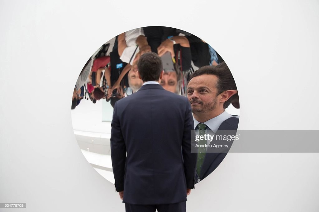 A man looks at one of the artworks by Indian-British sculptor Anish Kapoor during the exhibition press preview of 'Archaeology: Biology' at University Museum of Contemporary Art in Mexico City, Mexico on May 27, 2016. This exhibition offers a wide-ranging perspective on Kapoors workwith sculptures dating from 1980 to 2016.