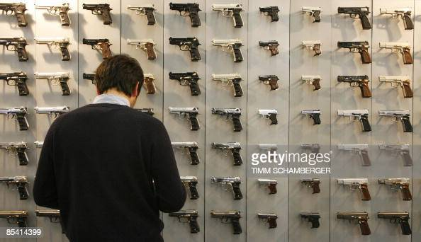 A man looks at pistols on display at the weapons trade fair in the southern German city of Nuremberg on March 13 2009 A heated debate on gun control...