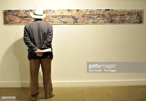 A man looks at River Scroll by artist Max Naylor as more than fifty works of art inspired by the Thames Diamond Jubilee River Pageant go on free...