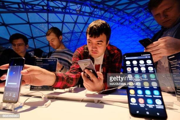 A man looks at Samsung smartphones during a presentation of the new Samsung Galaxy S8 at the Russian market of electronic devices in Moscow on April...
