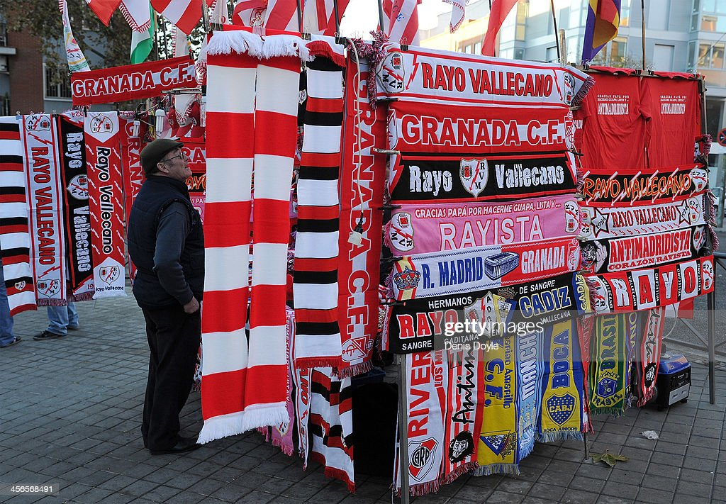 A man looks at scarves at a stall outside Estadio Teresa Rivero before the La Liga match between Rayo Vallecano de Madrid and Granada CF at Teresa Rivero stadium on December 14, 2013 in Madrid, Spain.
