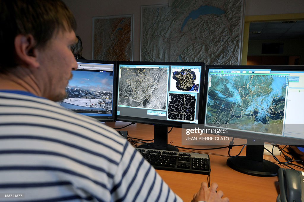 A man looks at screens at the weather station of Chamonix, French Alps, on December 26, 2012, to prepare forecasts and to evaluate the risk of avalanches.