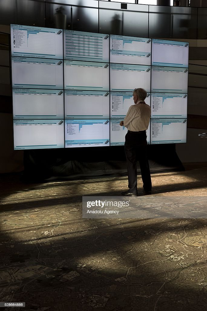 A man looks at screens displaying London Mayoral election results in London, United Kingdom on May 06 2016. Khan becomes London's first muslim mayor.