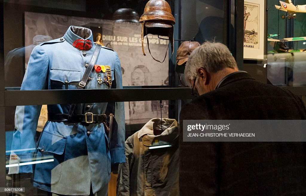 A man looks at soldiers belongings and equipement displayed for the exhibition that commemorate the 1916 Battle of Verdun in the redesigned Memorial of Verdun. The memorial will reopen on February 22, 2016. VERHAEGEN
